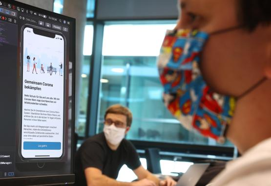 Florian Heretsch and Emil Voutta of the developing team of software giant SAP work on the German government official COVID-19 tracing App at the SAP headquarters, as the spread of the coronavirus disease (COVID-19) continues, in Walldorf, Germany May 29, 2020. REUTERS/Kai Pfaffenbach