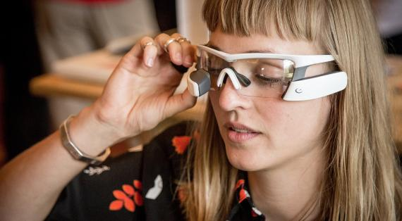A Woman using glasses with AR/VR technology