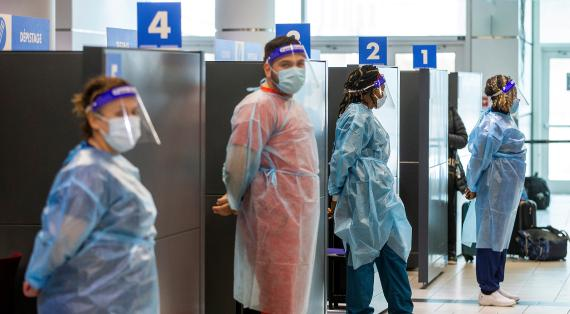 Healthcare workers prepare to test passengers as they arrive at Toronto's Pearson airport after mandatory coronavirus disease (COVID-19) testing took effect for international arrivals in Mississauga, Ontario, Canada