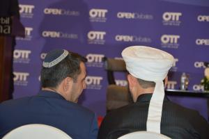 A representative from the Jewish community in discussion with a delegate from the Muslim community