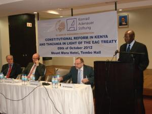 Justice Philip Tunoi delivering the keynote speech. Looking on from L-R are H.E. Amb. Brandes, Hon. Kauder and Prof. Roschmann