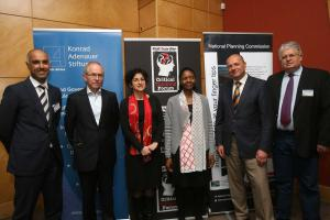 The discussion participants with Percy Moleke, National Planning Commission, and Dr. Holger Dix, KAS: Prof. Aviansh Govindjee, Mr. Ian Macun, Dr. Miriam Altman, Mrs. Percy Moleke, Dr. Holger Dix and Mr. Gerhard Papenfus (f.l.t.r.).