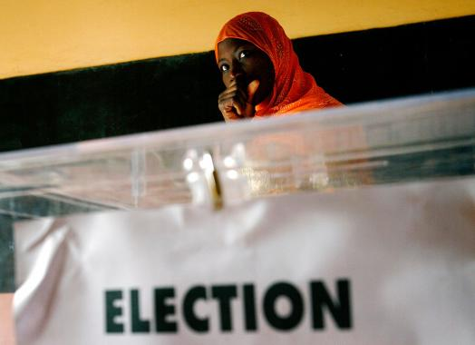A Senegalese woman waits to cast her ballot at a voting station during presidential elections in the capital Dakar.