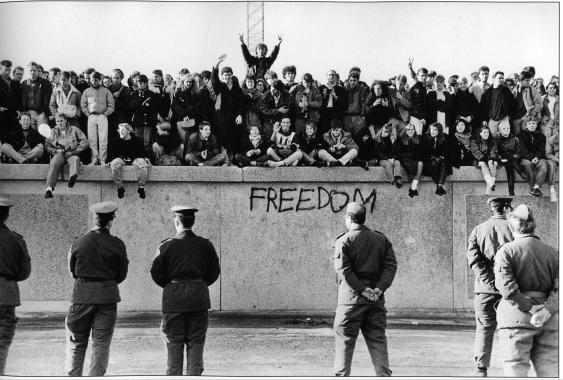 November 1989, people celebrating on top of the Berlin Wall