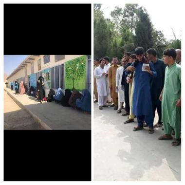 Men and women waiting to vote in Afghanistan