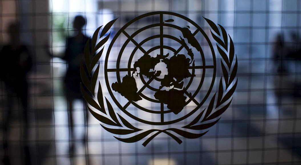 The United Nations logo on a glas door.