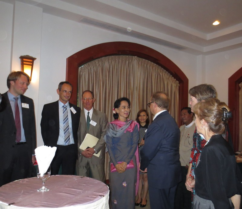 Experts from Sydney Law School and head of the Rule of Law, Programme Asia Marc Spitzkatz (second from left) interact with Nobel Laureate and Chairperson and Secretary of the NLD, Aung San Suu Kyi.