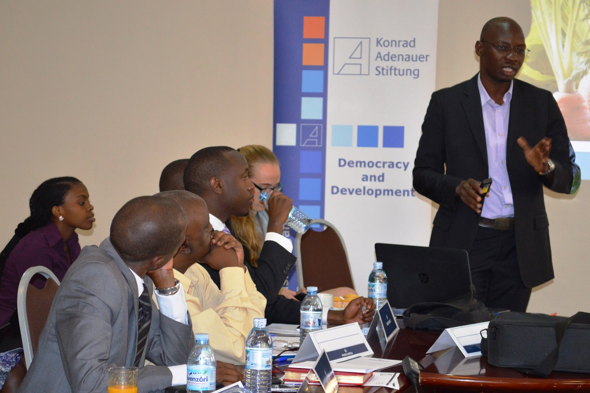 Jasper Oketa guiding the discussion during the roundtable meeting