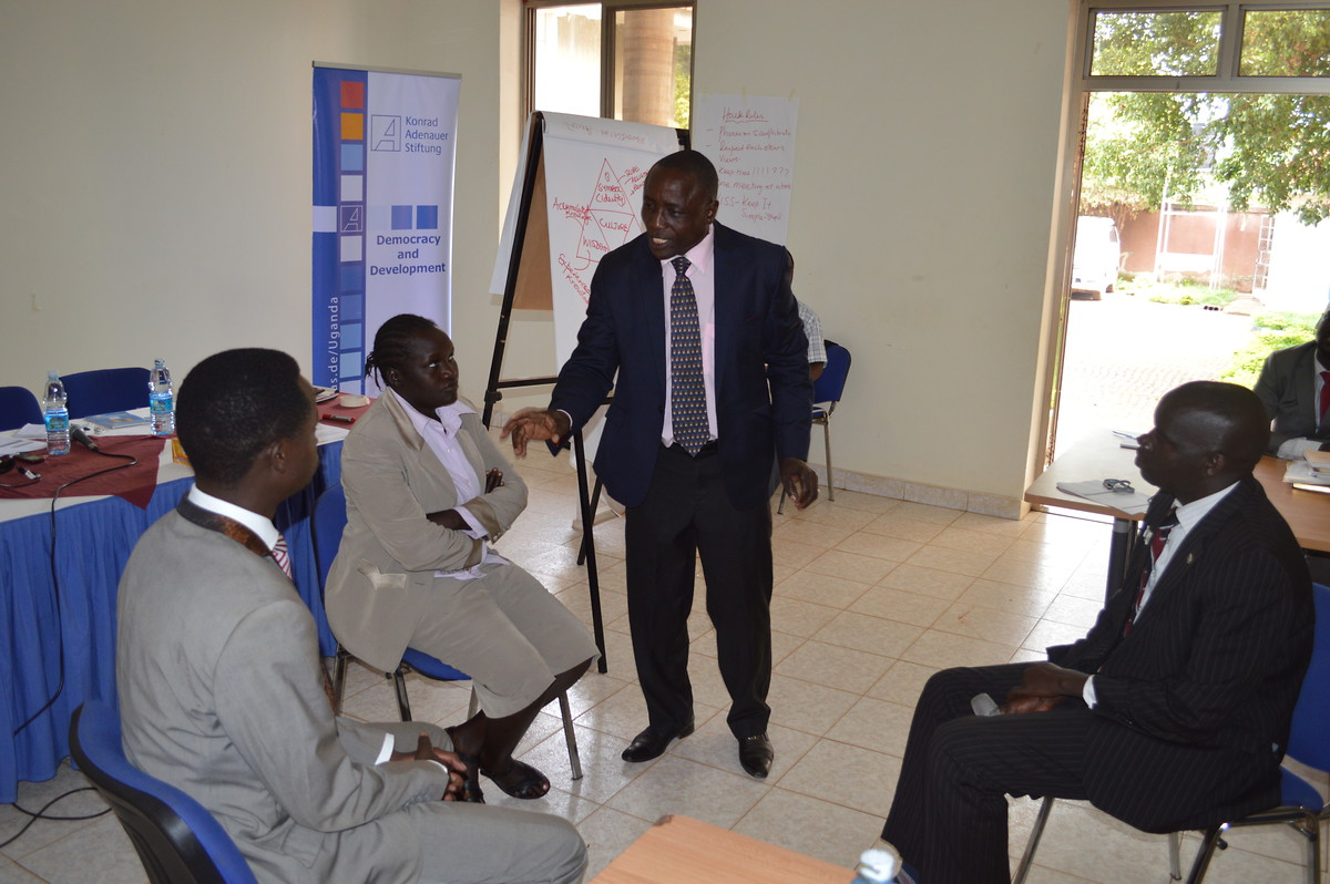 Local Youth Council Leaders participating in a role play on how to best represent youth interests in the local system of governance, led by Mr Geoffrey Kyeyune, ILO Trainer
