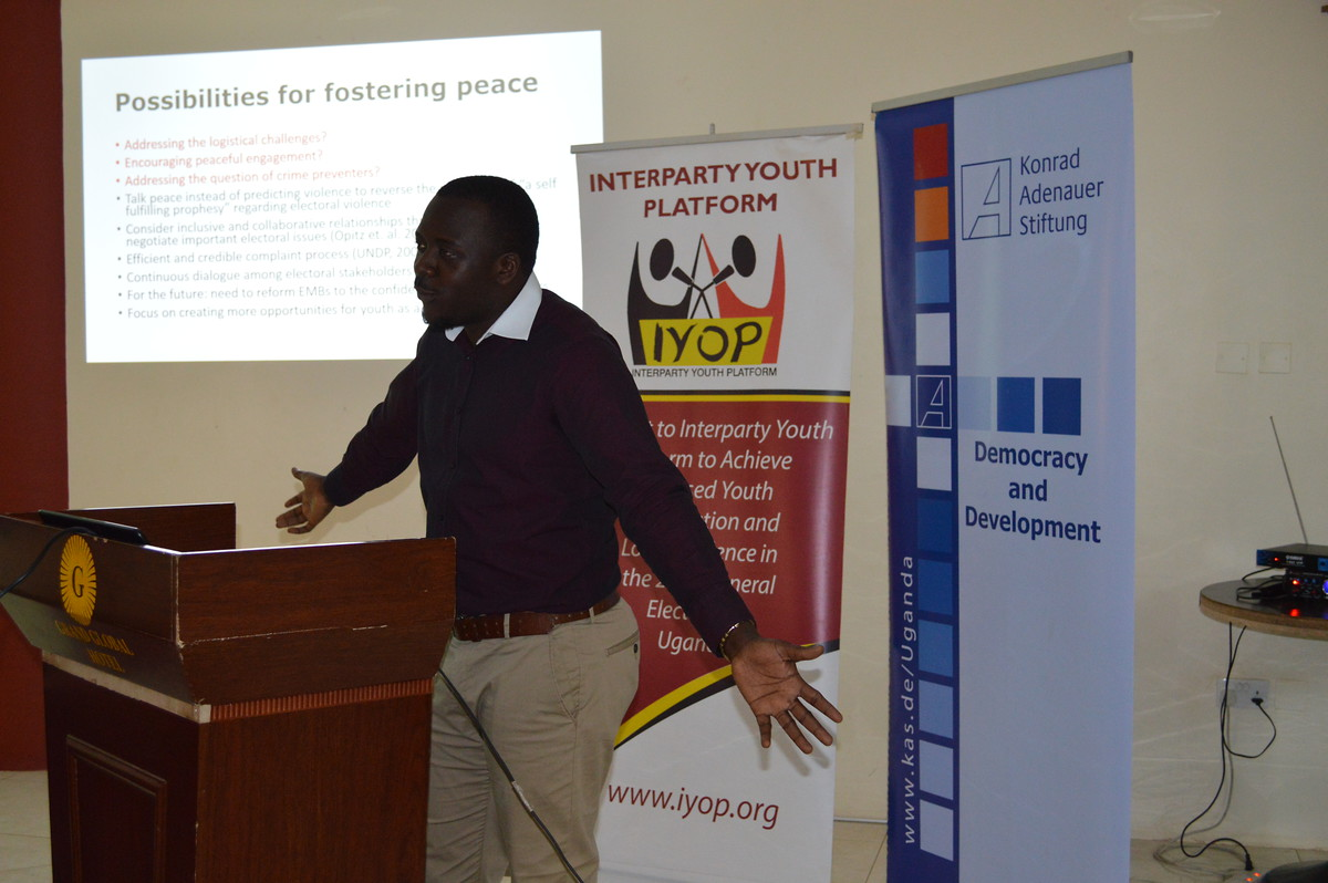 Yusuf Kiranda, a governance specialist presenting a scientific perspective on youth's role in Electoral Processes