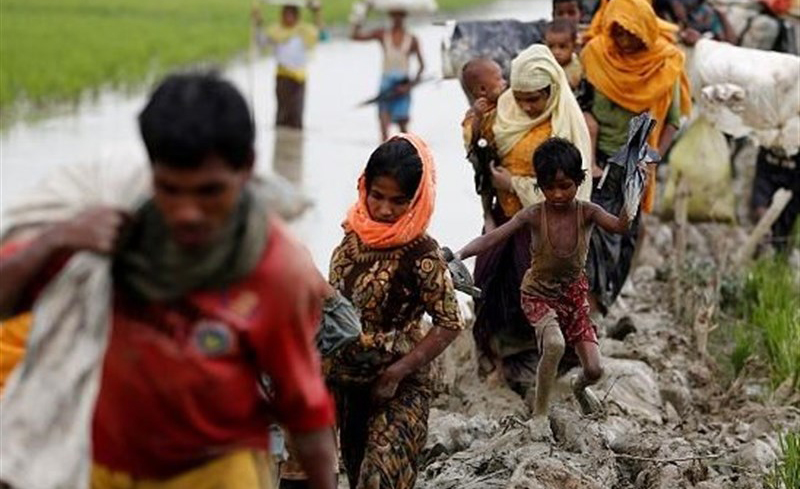 Rohingya refugees entering Bangladesh after being driven out of Myanmar
