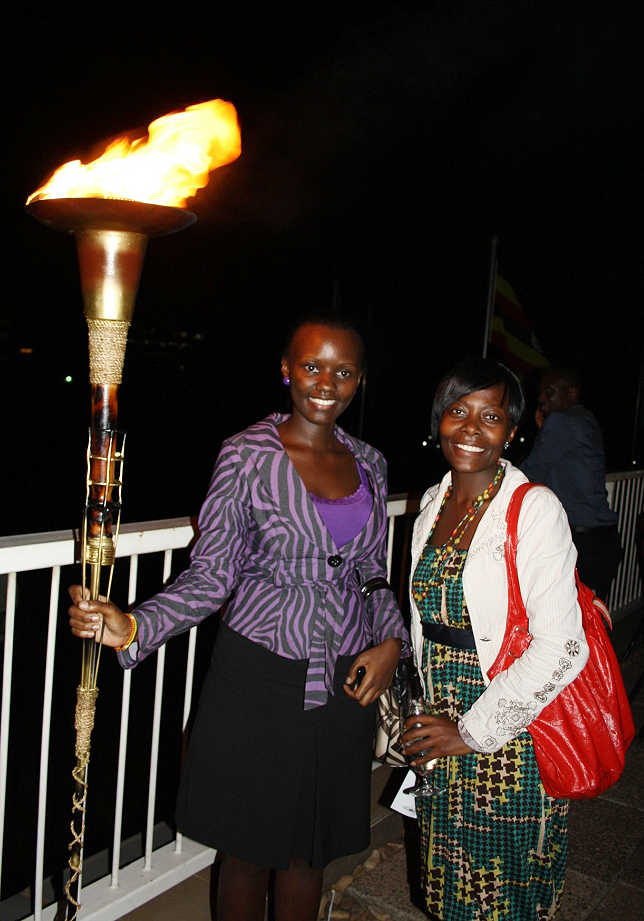 Guests posing with the Democracy Torch